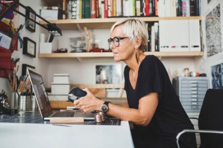 Female industrial designer using laptop