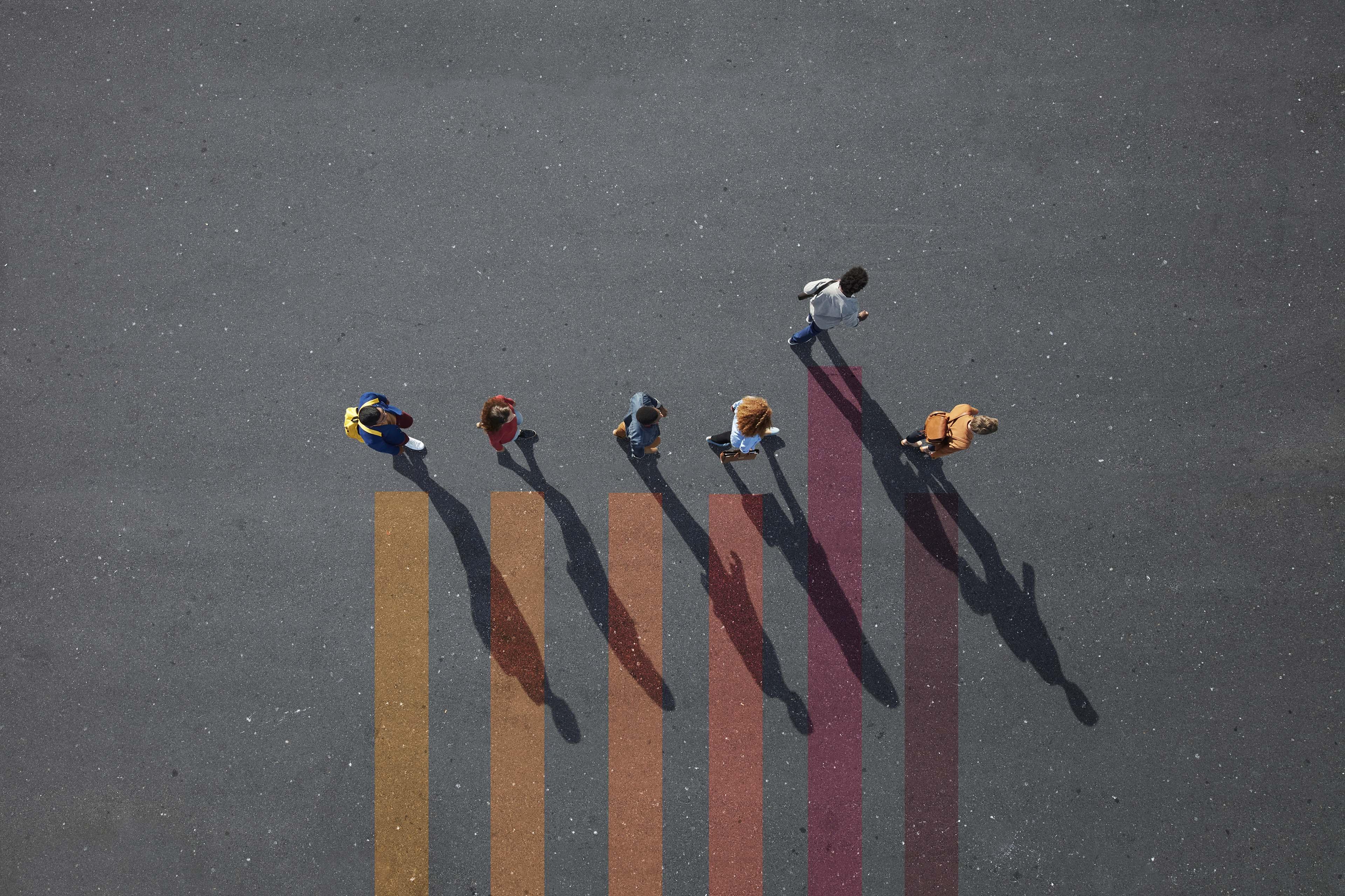 People walking on colored lines painted on asphalt