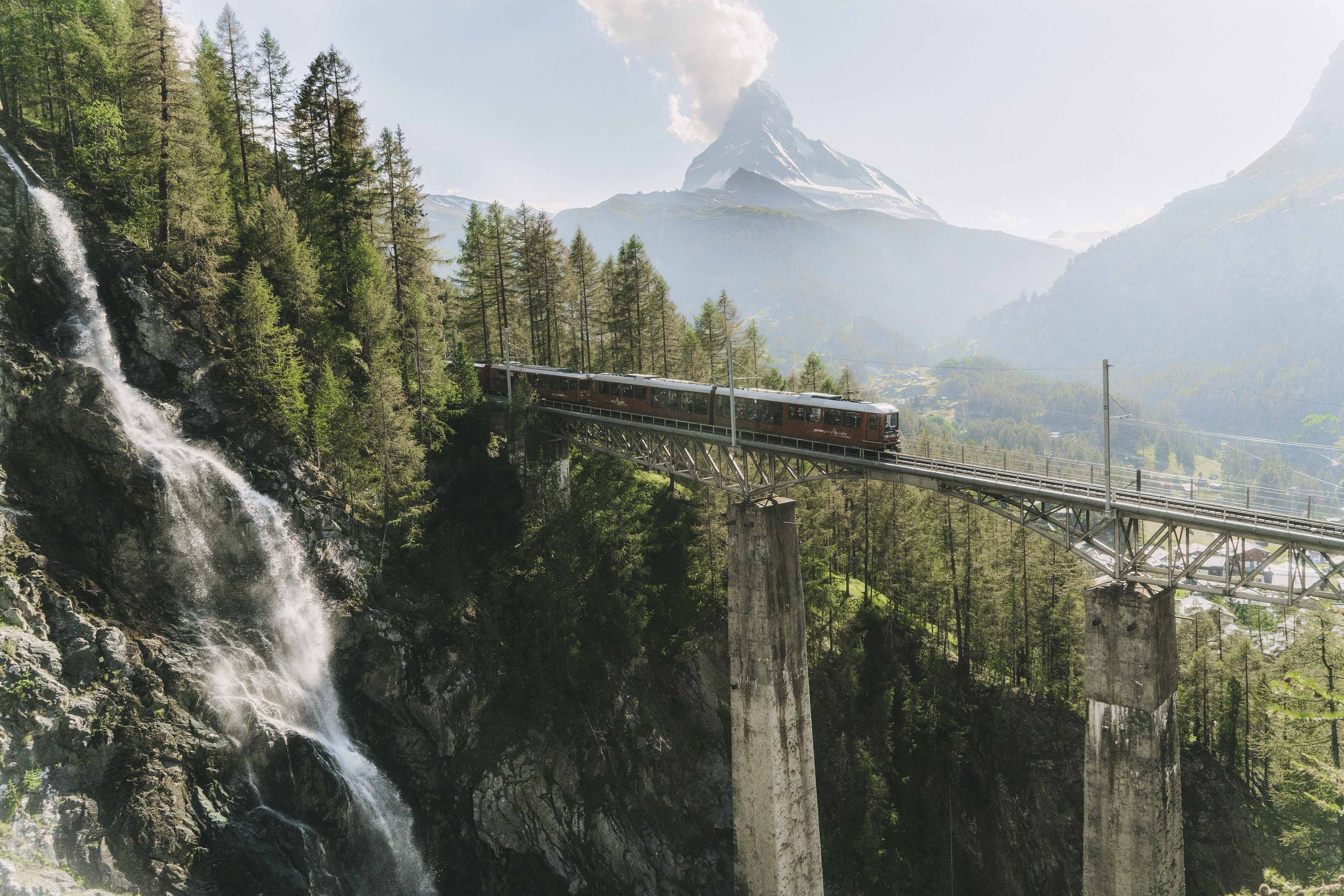 Scenic view of train with mountain background