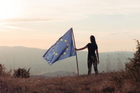 Woman holding European Union flag