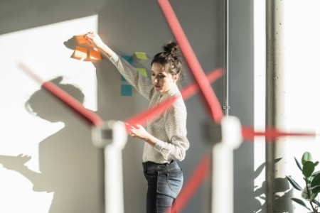 Woman planning with sticky notes