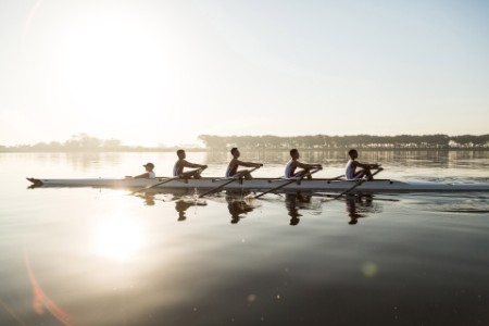 A rowing team on the water.