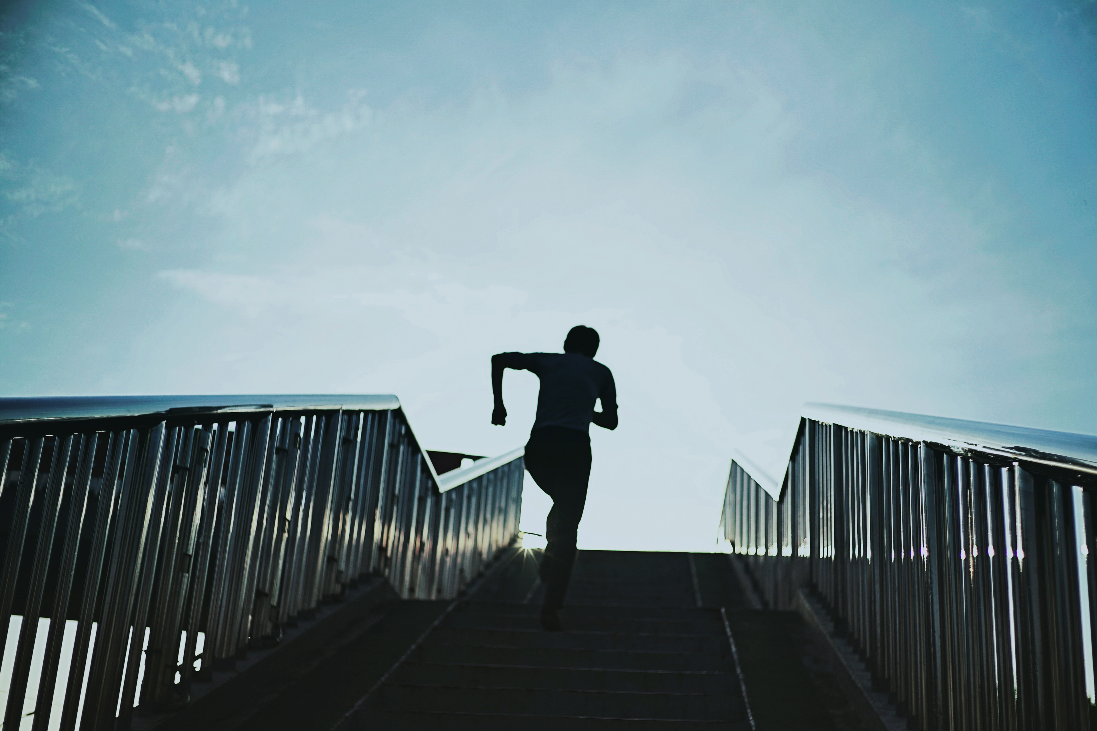 Man Running On Steps Against Sky