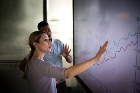 woman showing results on a graph
