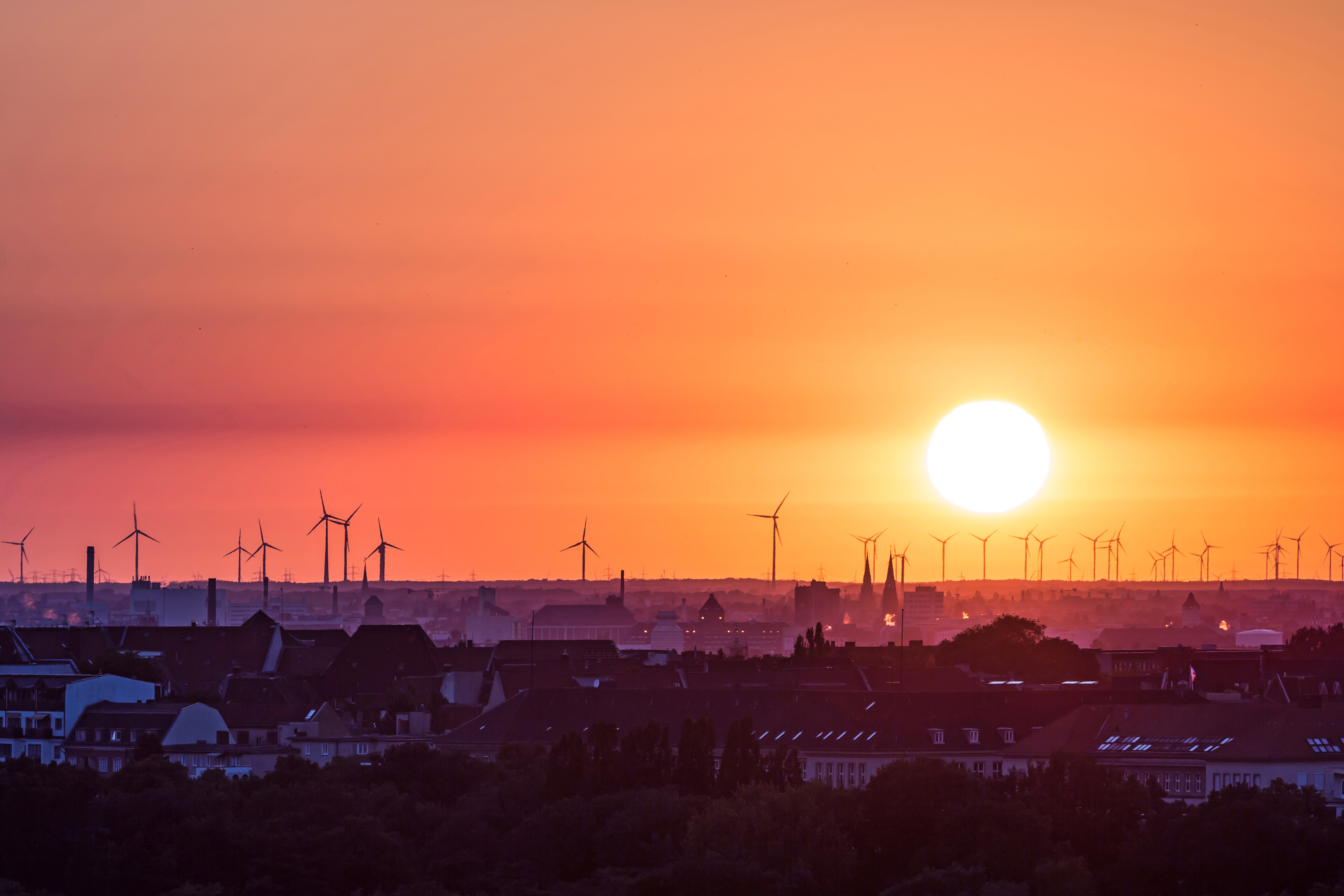 Wind turbines near Berlin/ Germany with colorful sunset