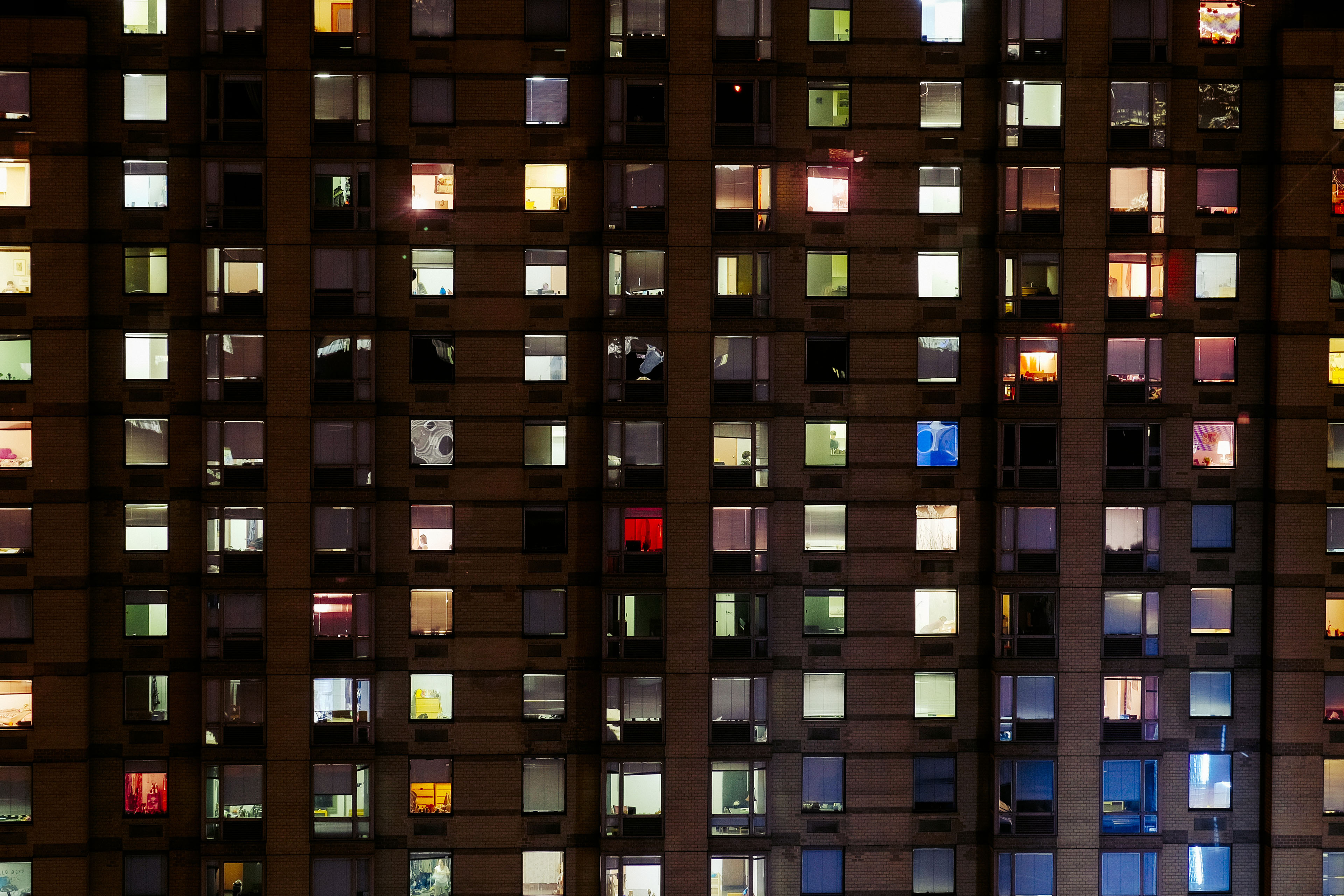 Rooms are lit at night in New York City.