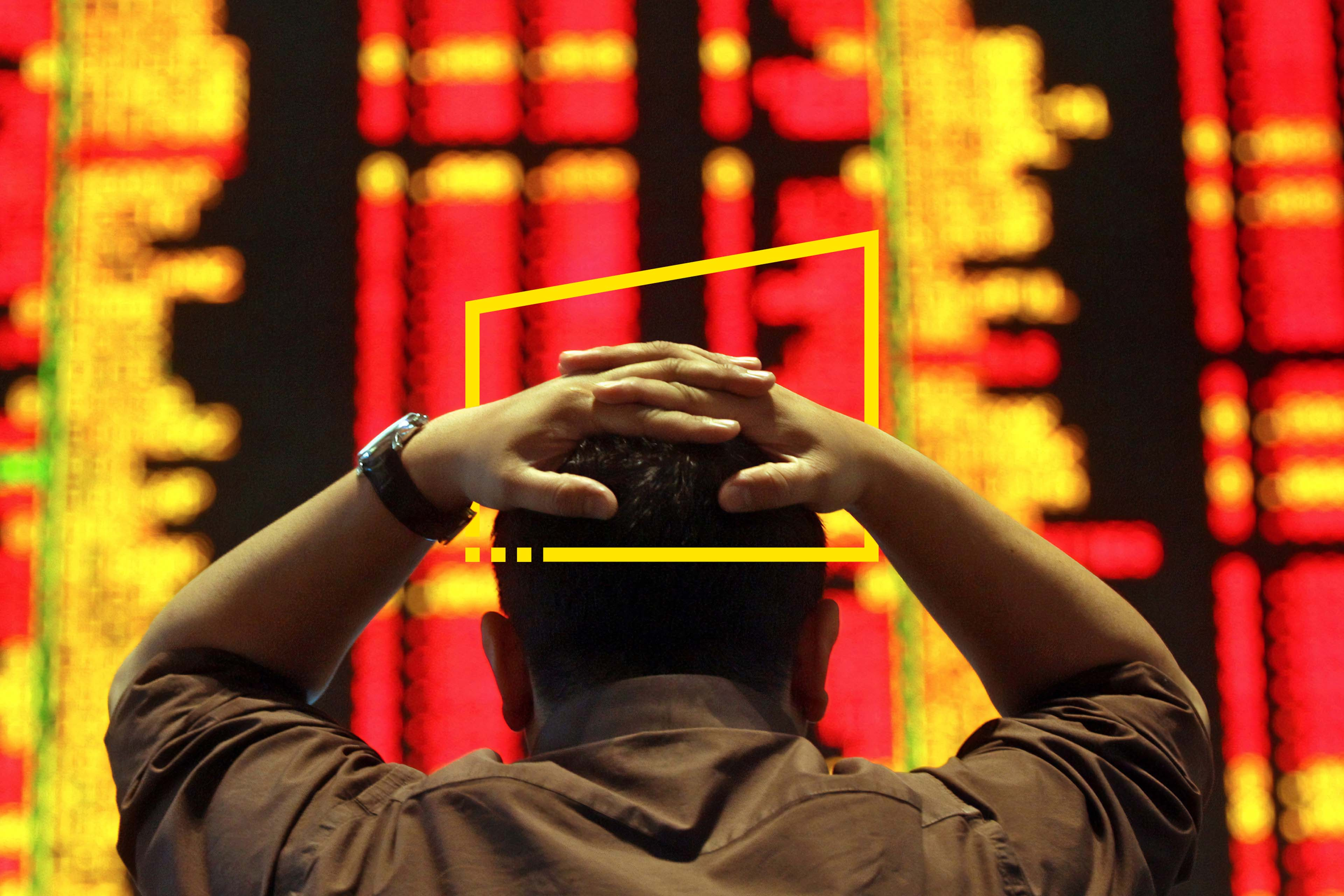 ey-an-investor-reacts-as-he-monitors-the-share-index-in-a-stock-market-gallery-static
