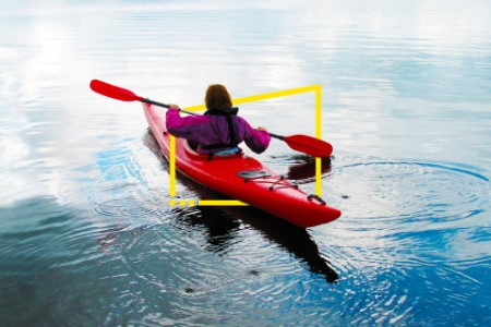 Woman kayaking on a big lake in Sweden.