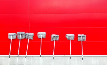 Red background with row of mops lined up