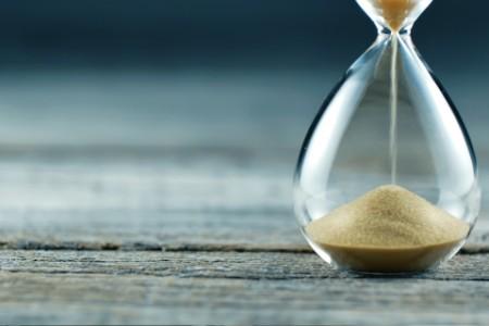 Sand dripping through sand timer