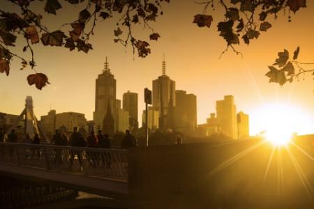 Rising sun across the city skyline