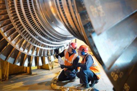 Workers inspecting power turbine