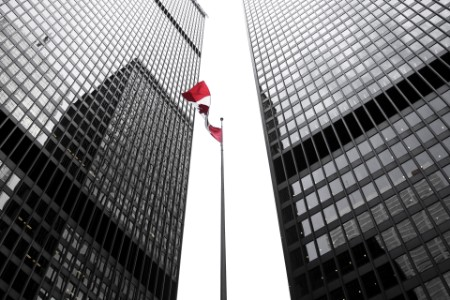 EY - Canada flag amongst office buildings