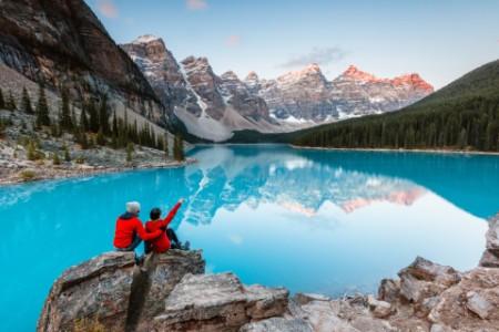 blue lake reflecting mountain peaks