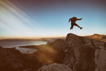 man jump cliff