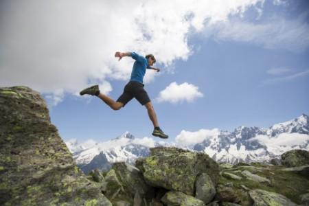 EY - Man jumping mountains