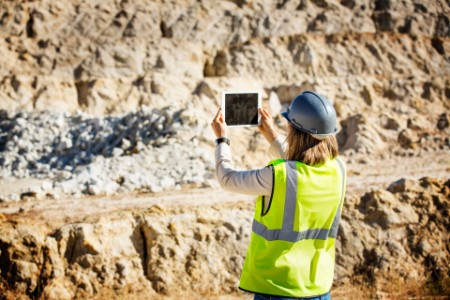 EY - Miner using tablet British Colombia