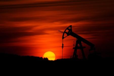 EY - Sunset on oil field