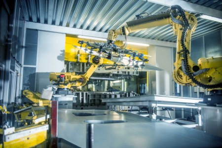 EY - Car parts handled by robots in car factory