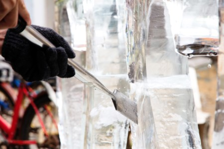 EY - Ice carver using chisel to carve