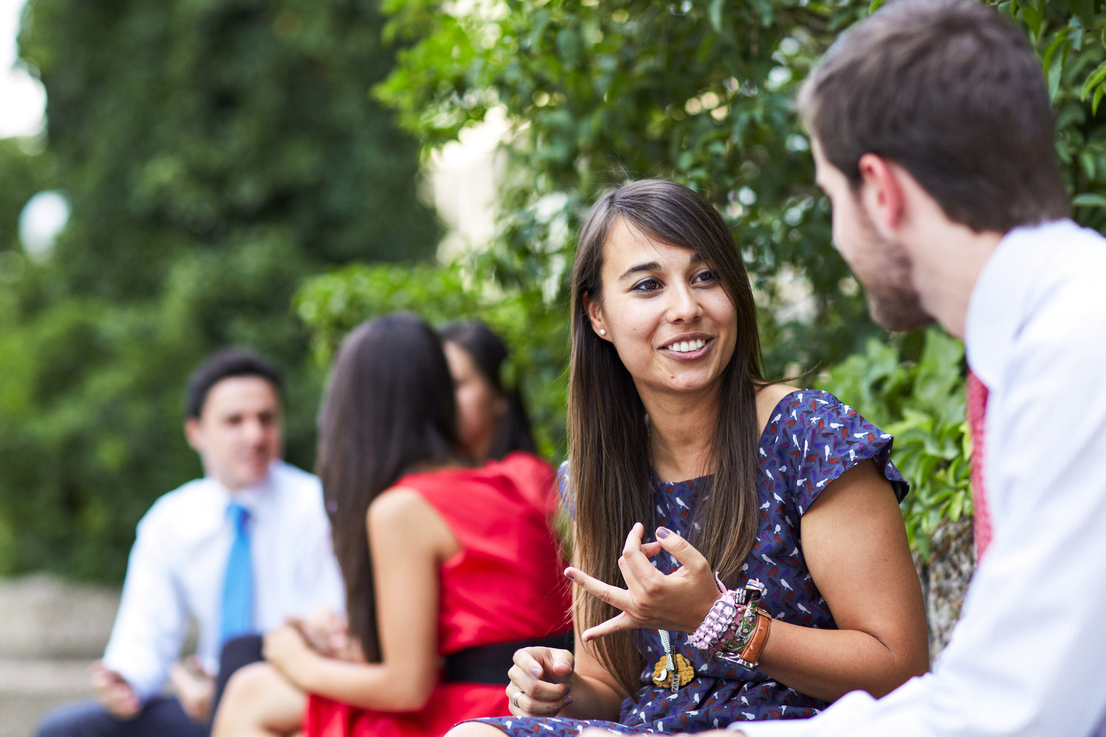 Business people sitting outdoors in conversation