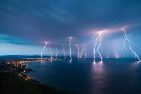 Thunderstorm with lightnings over the water