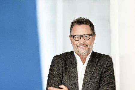 A portrait  photograph of Wim Ouboter