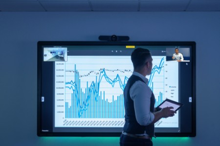 Businessman using video conferencing interactive screen business meeting