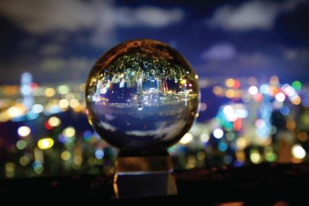 glass ball mirroring city lights