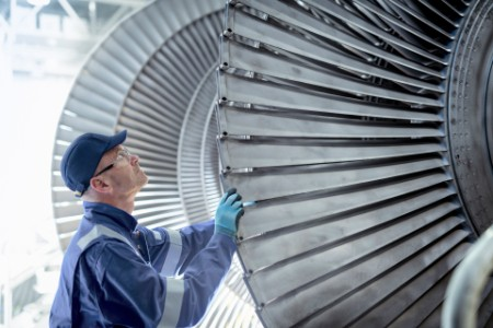 Close up of engineer inspecting low pressure turbine