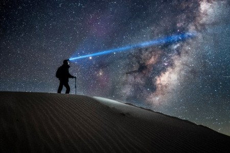 Man sand dune headlamp milky way