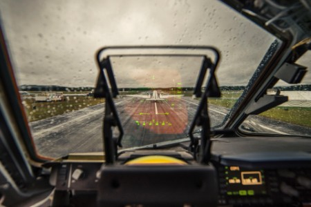 Airplane runway sky through wet windshield