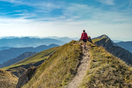 Senior woman hiking in the allgaeu alps
