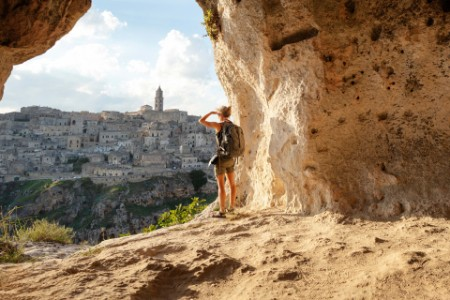 Women looking view cave matera policy outlook 2021