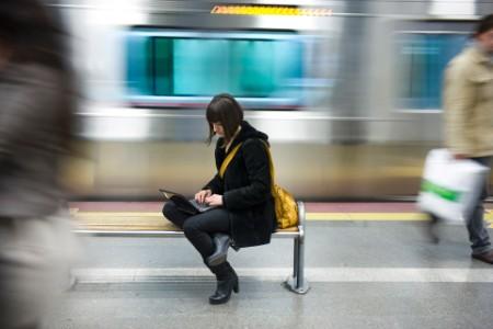 woman bench subway station computer
