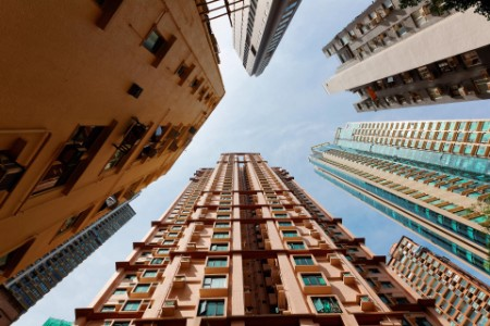 Low angle view of high rise residential towers in Hong Kong