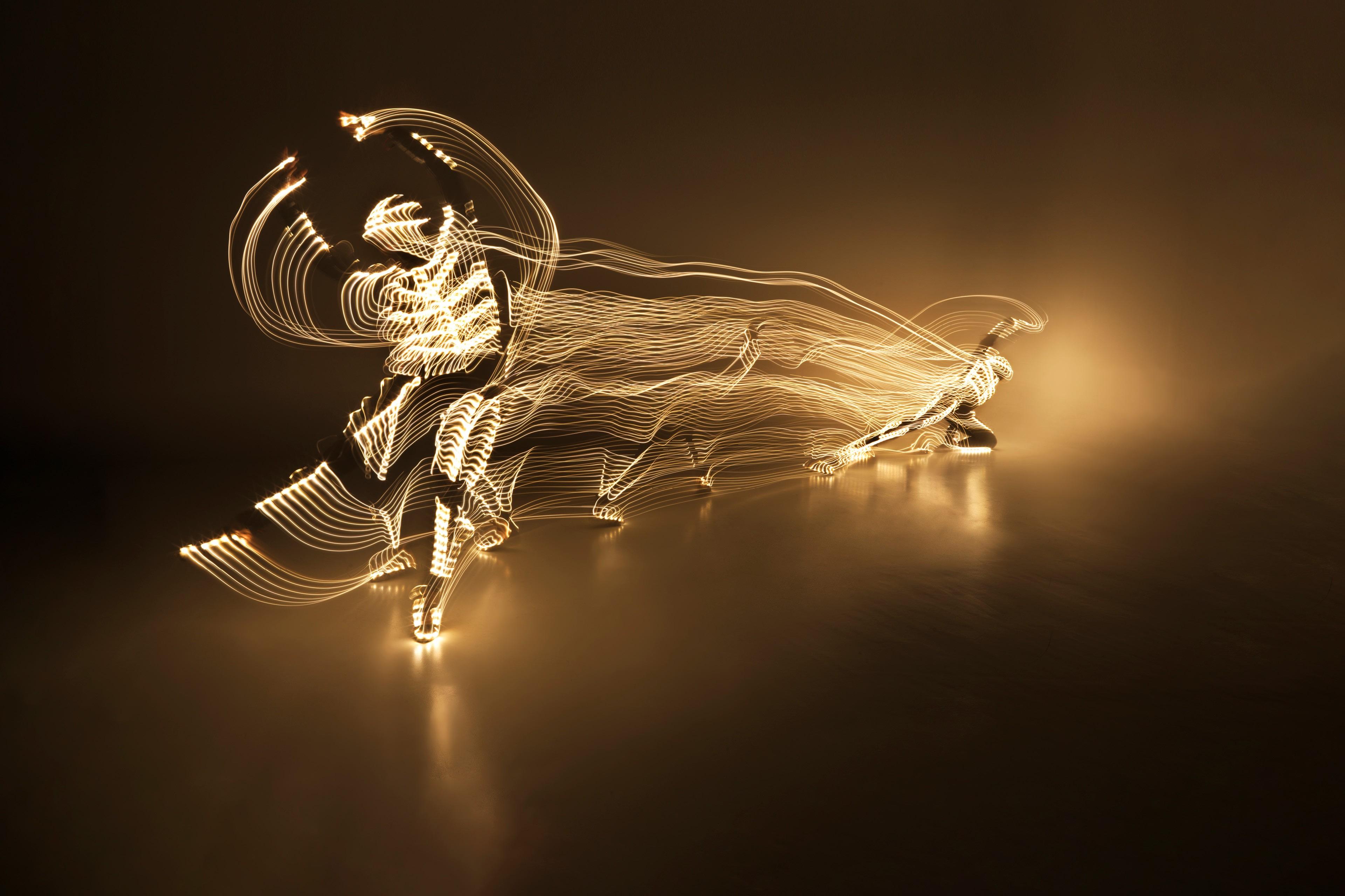 Ballet dancer in a light suit