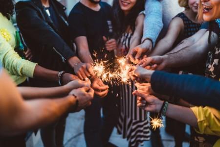Friends circle celebrate fireworks