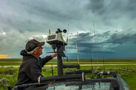 adjusts rooftop weather station storm