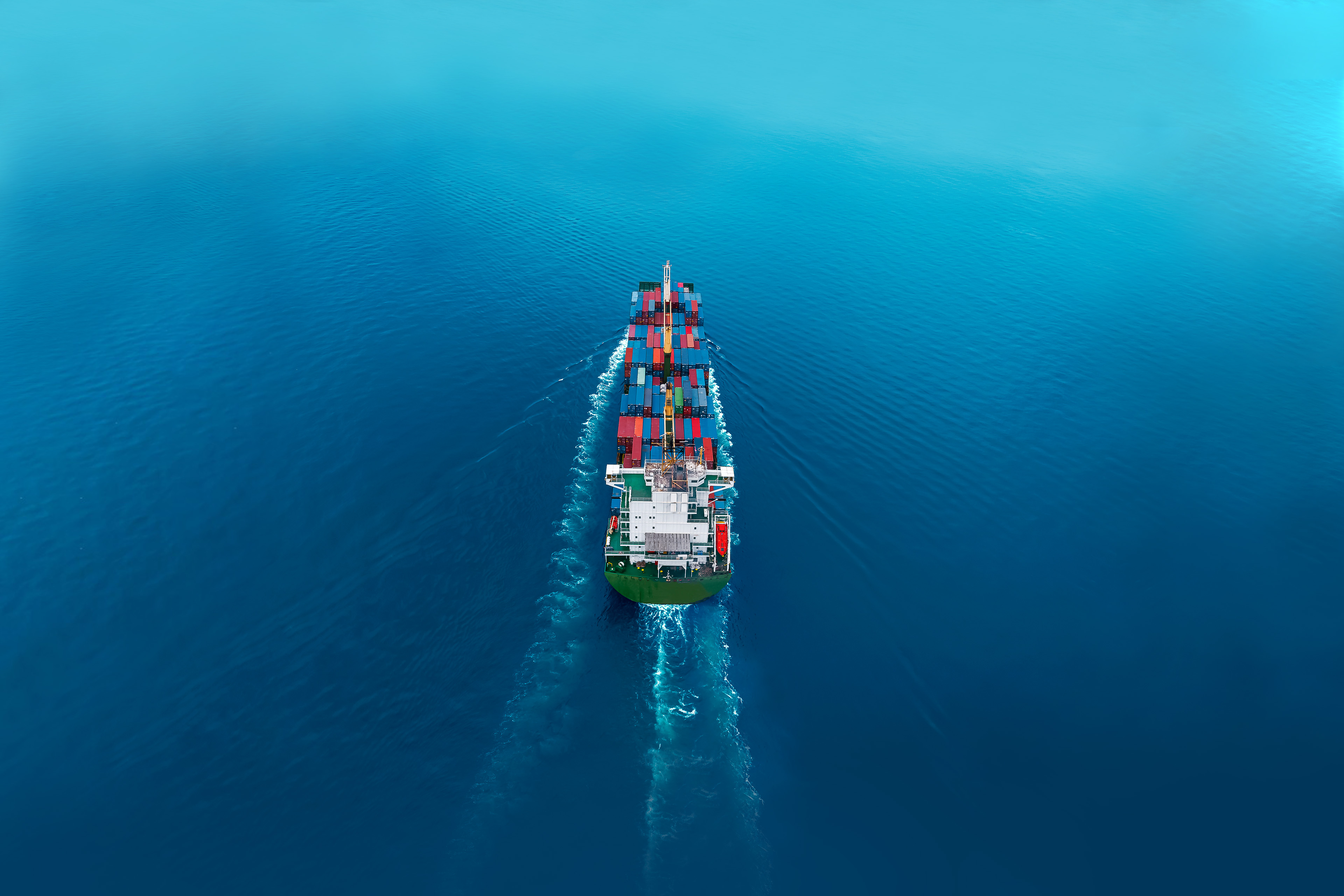 Aerial view of cargo ships in containers sailing in the sea