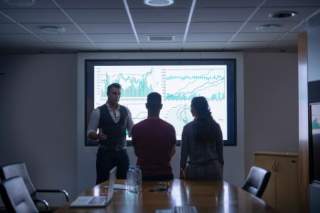 Business team with graphs and charts interactive screen meeting