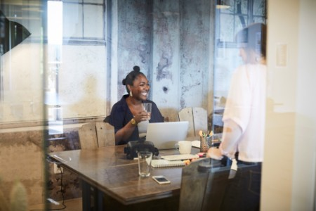 Business woman in meeting with laptop