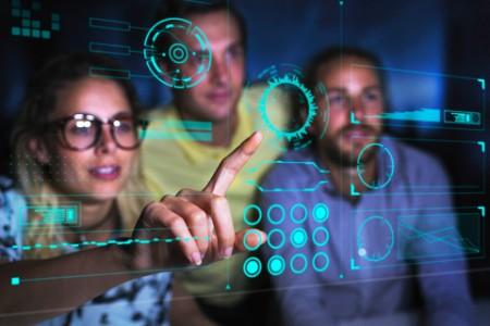Computer programmers examining data