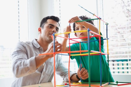 Father son building tube blocks table house