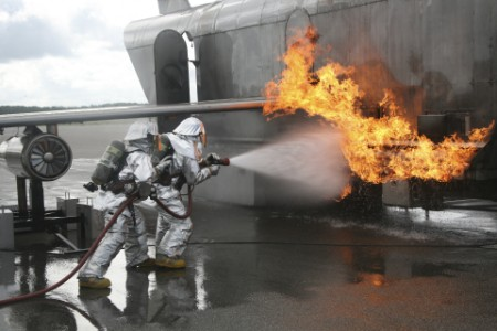 Fire fighters near an aircraft