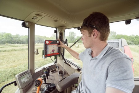 Man setting control panel in tractor farm