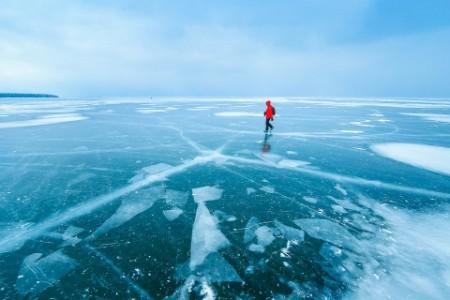 Man walking across frozen lake
