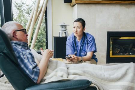 Nurse cell phone visiting patient