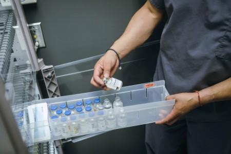 ey-nurse-examining-vial-medicine