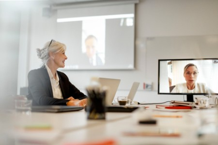 Senior businesswoman on video call in office